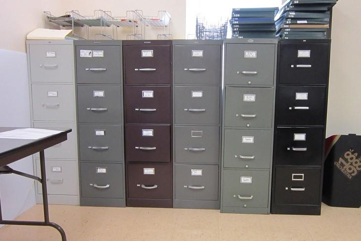 Imágenes de archivadores en relación con un programa de facturación para taller